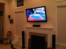 flat screen tv on wall with surround sound. photo of infinite designs home theater pros - charlotte, nc, united states. flat screen tv on wall with surround sound o
