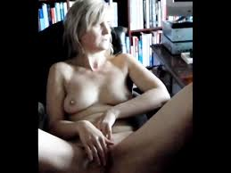 Solo girl watches porn and masturbating
