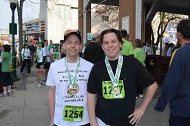 after everyone was done we got some pictures by the pavilion here s my brother and i with our race medals awesome bling i might add especially for a 10k