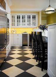White kitchen dark tile floors Fun Kitchen Warmed By Taxiyellow Tiles On The Backsplash And Blackandbeige Checkerboard Tile Floor This Mostly White Kitchen Is Sleek But Not Cold Way2brainco Design Ideas For White Kitchens Traditional Home