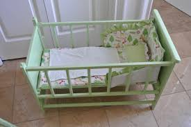 interior minimalist diy baby crib in light green color with green cloth and tiny green