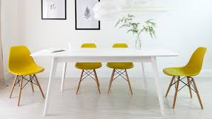 matt white extending dining table and eames chairs