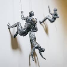 climbing men wall decor remarkable trio strong fun novelty a coils in wire home design 2