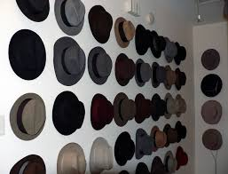 wall of hats - showroom - on brick