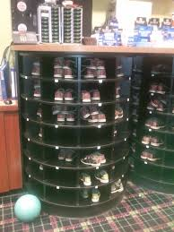 inspiring storage ideas with dark rotating shoe rack
