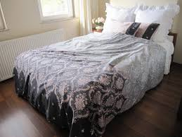 simple dorm room with two pieces pillow cases and dusty pink grey damask print queen bedding
