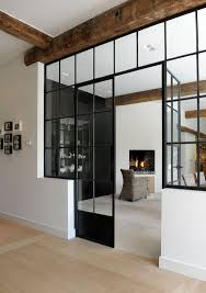 black framed french doors for connecting the interiors with each other