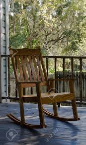 old wooden rocking chair sitting on a porch stock photo 2303370