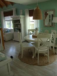 photo credits dining area by dwight loudon from rate my e notice the natural light colored floorboards the sisal rug painted furniture