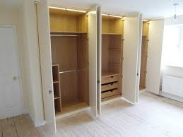 led strip lighting used to light the inside of a fitted bedroom wardrobe operated by switches on the doors
