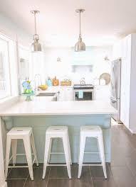 gorgeous coastal style white shaker kitchen with aqua