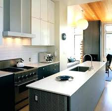 mid century modern kitchen island white bronze faucet black marble drawer on concrete floors stainless steel