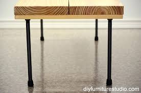 plumbing pipe desk diy rustic modern coffee table or bench with legs view from one end