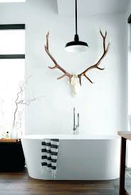 antler decor ideas antler towel holder gives this modern bathroom a cabin feel deer antler wall