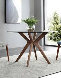 round clear glass table with wood legs
