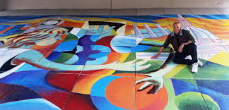 lansing artist brian whitfield is composing four murals on the embankments beneath the u s 127 overpass at michigan avenue where lansing and east lansing
