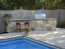 outdoor stone kitchen comes from a kit