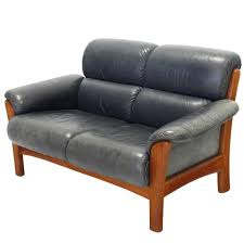 leather and solid teak mid century modern danish loveseat for