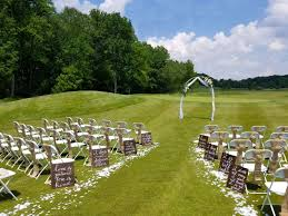 a beautiful outdoor wedding setup at the links at challedon