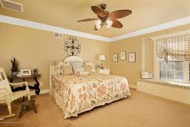 pictures of bedrooms with ceiling fans. traditional guest bedroom with crown molding, window seat, high ceiling, flush light, pictures of bedrooms ceiling fans 1