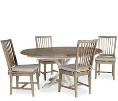 the hyannis 5 piece dining set features a two tone rustic distressed terrace gray washed linen finish and features foot levelers