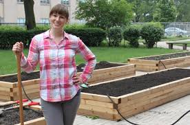 garden director renea solis standing beside a raise
