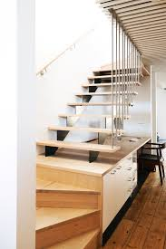 cottage place mid sized scandinavian wooden u shaped staircase idea in melbourne automatic led stair lighting