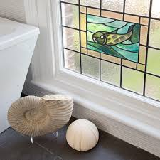 a stained glass window treatment is a great way of adding colour made using sections of glass held together with leading designs vary from a simple border