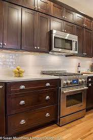 i also like the light floors with dark cabinets wasnu0027t sure would it until saw this white subway tile backsplash brown cabinets o52 brown