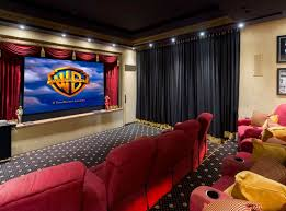 theater curtains next to wall mounted tv and swag curtains on top