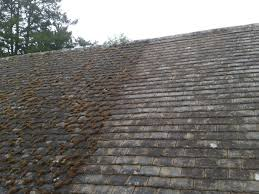 photos of the roof moss removal and roof cleaning process