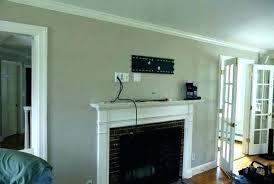 mount tv to brick fireplace mount on brick fireplace above fireplace wires how to hide wires mount tv