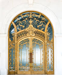 door made of wood gold and gl reflecting arch white