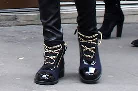 chanel boots. cara delevingne blue and black chanel boots