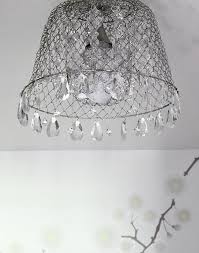 diy chandelier this blogger takes an ordinary mesh basket and turns it into something stunning