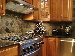 soft and dark gray rhombus shape tile back splash completed with light brown wooden cabinet also