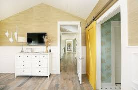 view in gallery yellow barn door adds color to the eclectic bedroom design four chairs furniture