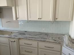 kitchen plain grey island countertop white frame windows backsplash tile sofa arc corner cabinet in