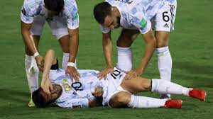 Lionel Messi tackled by Luis Martinez ...