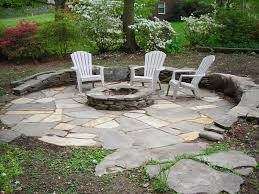flagstone patio with a fire pit