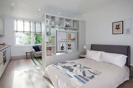 Use the open shelf as a room divider in the master bedroom with  conversation nook [