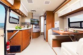 Unity motorhome combines murphy bed and swivel recliners in comfy, flexible lounge. Rent Unity Rv From Leisure Van
