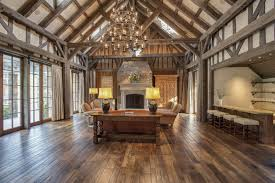 a vaulted ceiling and exposed wood beams give the great room and bar a barn