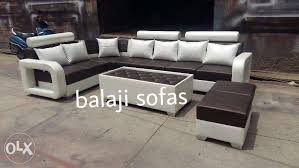show only image brand new l shape sofa set with 2 puffies center table