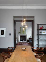 ideas for dining room lighting. contemporary room example of a minimalist dining room design in london with gray walls on ideas for dining room lighting m