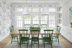 8 blond wood table with emerald green windsor dining chairs on dining room green