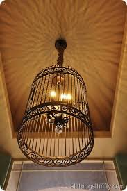 diy gorgeous birdcage chandelier from a large birdcage
