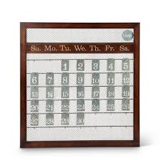 brown wood and metal perpetual calendar