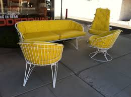 retro look furniture. a comfortable set of outdoor furniture that looks very retro and would look great with its surrounding hardscapes