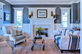 Living Room With Wainscoting And Wood Flooring